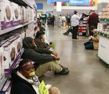 The Militant - December 15, 2014 -- Walmart actions back $15