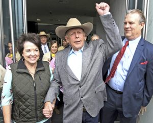 From left, Carol Bundy, rancher Cliven Bundy, his lawyer Bret Whipple, and his son Ammon, in back in hat, leave Las Vegas court after judge ruled government can't retry Cliven, Ammon and Ryan Bundy, as well as supporter Ryan Payne, because of prosecutors' deliberate misconduct.