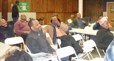"""In Cuba, if a worker is hurt, an immediate investigation is done. The focus is what those running the project should have done to prevent the accident,"" Griselda Aguilera said at Feb. 9 meeting, above, with Black construction workers of Laborers Local 79, one of a dozen events during her New York/New Jersey tour. Inset, Aguilera at citywide meeting at Nurses union hall Feb. 10."
