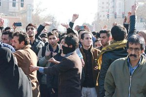Two weeks of working-class protests began in Mashhad, Iran, above, and spread to 90 other cities and towns, ignited by opposition to cleric-led regime's reactionary wars abroad.
