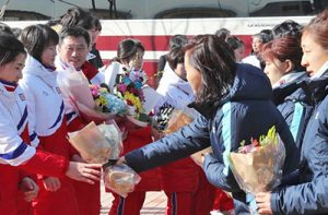 South Korean hockey players give bouquets to North Korean players Jan. 25 at Jincheon, South Korea, sports complex. This is first joint team between North and South Korea since 1991.