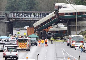 Amtrak train on first trip on new tracks spills onto highway in DuPont, Washington, after derailment Dec. 18. Bosses rushed to put crews on new bypass without adequate training.