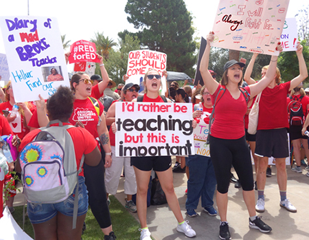 Thousands of teachers, supporters march in Phoenix April 30, demand funds, raises, respect.