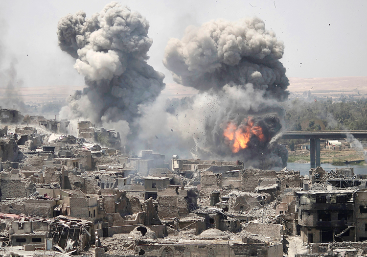 Airstrike of Mosul, Iraq, July 11, 2017, during U.S.-led coalition offensive. Pentagon admitted its forces caused at least 500 civilian deaths in Afghanistan, Iraq, Syria and Yemen that year.