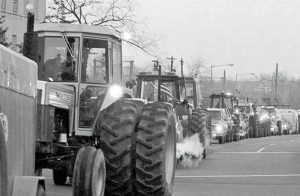 Tractorcade by thousands of farmers from across country arrives in Washington, Feb. 5, 1979. Organized by American Agricultural Movement, farmers occupied National Mall for weeks demanding parity - guaranteed prices for their crops at least equal to costs of production.