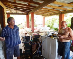 """Retired electrical worker Raúl Laboy, left, and Wilfredo Abreu, in Humacao, Puerto Rico, talk to Militant reporters. """"Social hurricane"""" of capitalism is worse than natural one, Laboy said."""