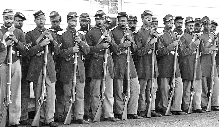 Above, Black troops in Union Army, most freed slaves, in Second American Revolution. Some 200,000 fought, many taking on the most daring tasks. Inset, Black troops run an artillery battery.
