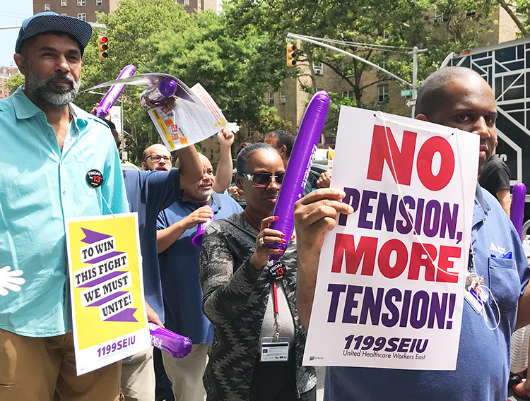 Local 1199 SEIU hospital workers picket Mt. Sinai Hospital in New York July 12, one of more than 100 actions statewide protesting bosses' moves to cut pensions, medical care and training.