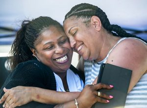 Samaria Rice, left, mother of Tamir Rice, killed by Cleveland cop in 2014, greets Michelle Kenney, Antwon Rose's mother, at celebration of what would have been Rose's 18th birthday.