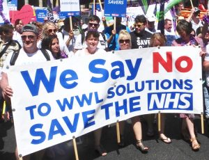 Contingent of striking hospital workers from Wigan, England, march in London June 30 on 70th anniversary of National Health Service. Their strike beat back bosses moves to privatize their NHS jobs and open attack on wages, working conditions and against health care.