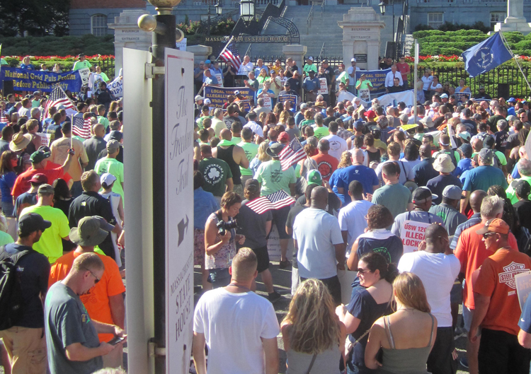 Members of United Steelworkers union, locked out by utility company National Grid, and their supporters march in Boston July 18 against bosses' demands for cuts to health care, pensions.