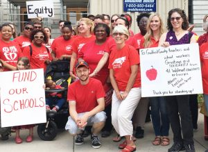 Rachele Fruit, right, candidate for Georgia governor from Atlanta, brings solidarity from fellow Walmart workers to June 7 teachers protest outside Guilford County Commission hearing in Greensboro, North Carolina. Left, Dan Fein, candidate for governor of Illinois from Chicago, joins march and rally June 23 at Waters Elementary School protesting attacks on immigrant workers.