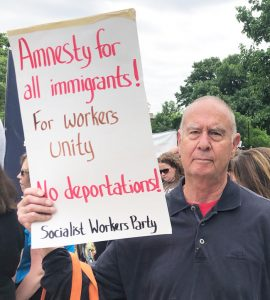 Dan Fein, candidate for governor of Illinois from Chicago, joins march and rally June 23 at Waters Elementary School protesting attacks on immigrant workers.
