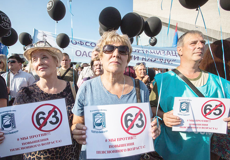 """We oppose raising the retirement age,"" say protest signs in Omsk, Russia. Government proposes to raise age for women from 55 to 63, reflected in signs, and from 60 to 65 for men."