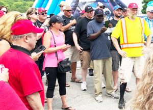 Striking salt miners discuss progress in negotiations on picket line in front of Compass Minerals salt mine in Goderich, Ontario, July 13, before new contract was won in militant strike.