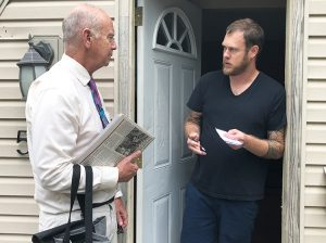 Dan Fein, left, Socialist Workers Party candidate for Illinois governor, talks with factory worker Jesse Bridges at his door while campaigning in Kankakee neighborhood July 29.