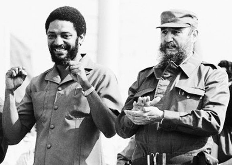 """Maurice Bishop, left, and Fidel Castro at May Day rally in Cuba, 1980. """"Grenada had become a true symbol of independence and progress in the Caribbean,"""" Fidel Castro said after Bishop was killed in counterrevolutionary coup. """"No one could have foreseen the tragedy"""" to come."""