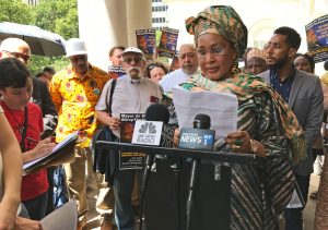 Hawa Bah speaks at Aug. 1 news conference demanding Mayor Bill de Blasio end appeal of court ruling awarding her family $2.21 million for cops killing her son Mohamed Bah in 2012.