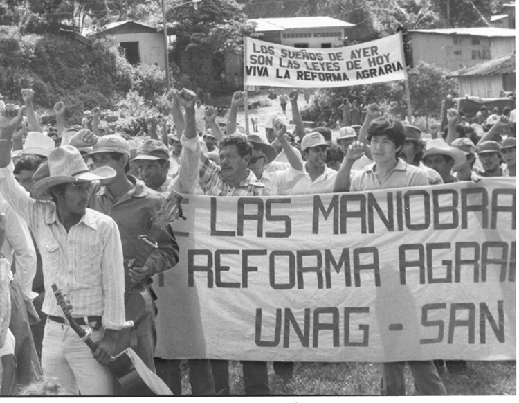 "Peasants celebrate land reform, Santo Tomás, Nicaragua, Dec. 11, 1983. In early years of revolution FSLN responded to peasants fight for land. But over next few years reversed themselves, promising ""patriotic"" landlords their property would be protected and land reform was dead."