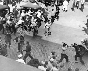 "Above, workers fight off assault by police and national guard in May 1934 Teamster strike. In 1941 trial of revolutionary Teamster and Socialist Workers Party leaders, prosecutor asked James P. Cannon if this fight against the deputies ""was the kind of violence SWP advocated."" The deputies ""were organized to drive workers off the streets. They got a dose of their own medicine,"" Cannon said. ""I think workers have a right to defend themselves. If that is treason you can make the most of it."""