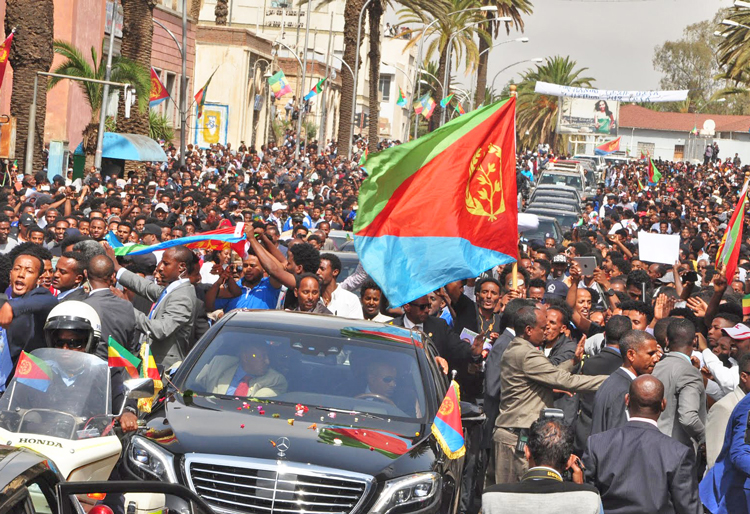 "Hundreds of thousands lined procession route from airport to center of Eritrea's capital Asmara when Ethiopia's Prime Minister Abiy Ahmed arrived July 8 to sign peace treaty after 20 years of war. Eritrean youth have been subjected to mandatory conscription for ""national service."""