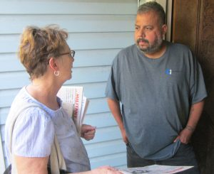 "Alyson Kennedy, left, SWP candidate for U.S. Senate from Texas, met Uber driver Jesus Alvarado on his doorstep in Grand Prairie, Aug. 20. He said he almost became homeless after losing his job in 2008. ""Working people need to unify to fight bosses' attacks,"" Kennedy said."