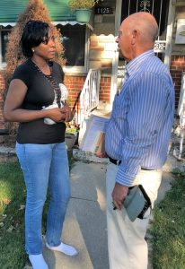 Dina Pickett, a teacher's aide, speaks with Dan Fein, SWP candidate for Illinois governor, at her house in Bellwood.