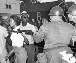 Civil rights fighter Gloria Richardson pushes aside National Guardsman's bayonet at July 21, 1964, Cambridge, Maryland, protest. Crime rate dropped 75 percent after start of Black rights protests there. Working-class solidarity counters dog-eat-dog morality of capitalism.