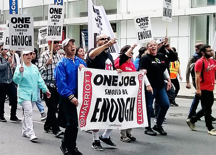 Hotel workers, members of UNITE HERE Local 2, march in San Francisco Sept. 3 after contract with Marriott hotels expired. Many are forced to work two jobs to make ends meet.