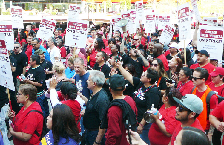"Thousands of hotel workers on strike in Chicago march through city demanding new contract. ""Hotel owners say we don't work enough hours to get health insurance,"" said housekeeper Laura McKinney at the demonstration. ""That's the main reason we're on strike."""