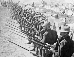 In 1898 Washington seized Cuba, Puerto Rico, Philippines and Guam from Spanish rulers, becoming the victor in world's first imperialist war. Above, U.S. invasion force with bayonets drawn are ready to defend their camp in Puerto Rico, which remains a U.S. colony to this day.