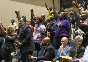 Protesters attend Dallas City Council hearing Sept. 12, demanding Dallas cop Amber Guyger be fired, jailed for shooting and killing of Botham Jean, 26, in his own apartment.