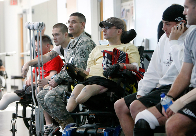 Wounded war veterans who get physical therapy wait at Brook Army Medical Center, San Antonio, Texas, in 2007. Veterans Administration has denied benefits to half a million veterans.