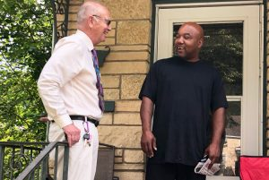 Dan Fein, Socialist Workers Party candidate for Illinois governor, talks with Willie Norwood, right, in Kankakee. Bedrock of party's campaigning is going door to door to talk with workers
