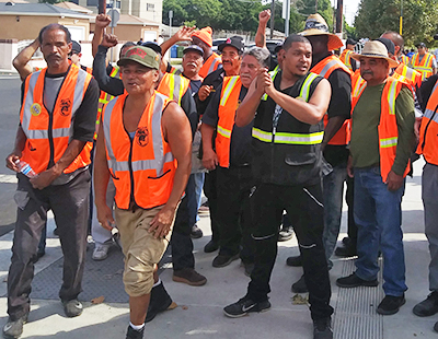 Cal Cartage warehouse workers join rally in Wilmington, California, Oct. 3, part of three-day strike alongside port drivers for right to join union. Strikers joined protest against White House order ending Temporary Protected Status for immigrants threatened with deportation.