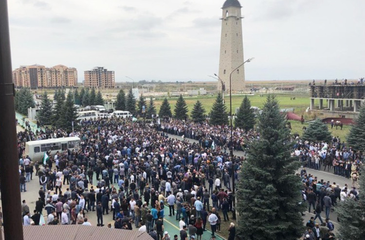 Thousands gather in daily protests in Magas, capital of Ingushetia, to oppose ceding of land to neighboring Chechnya by leader appointed by Vladimir Putin government in Moscow.
