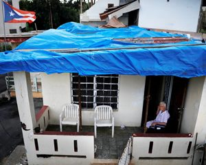 Tarp roof on worker's home in Puerto Rico.