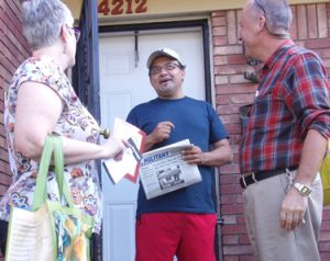 """Guillermo Perezlima, center, speaks with Socialist Workers Party members Amy Husk and Dean Hazlewood in Louisville, Kentucky, Sept. 22. """"As an immigrant, I've been treated differently,"""" Perezlima said, """"I work hard but they look at me differently."""" He purchased a Militant subscription and said he wanted to attend weekly discussions the party organizes."""