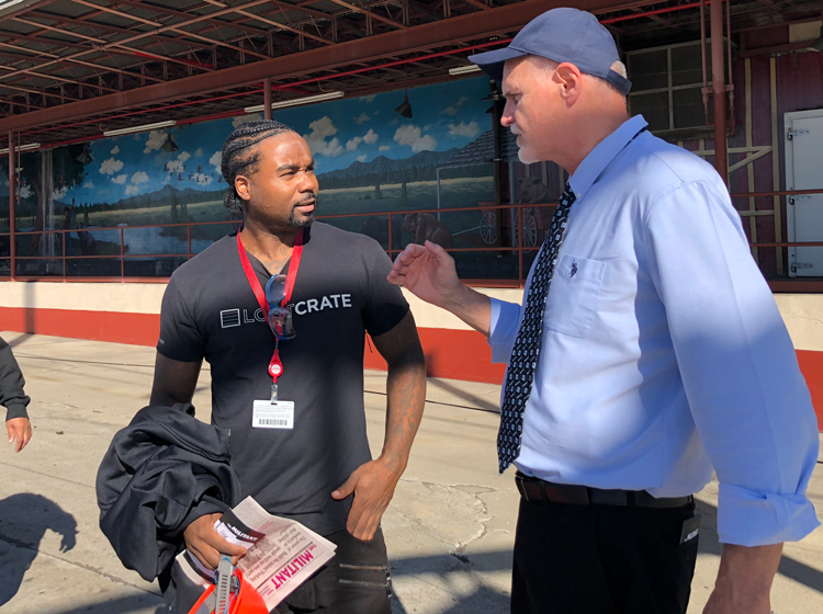 Dennis Richter, Socialist Workers Party candidate for US Senate in California during 2018 election, talks with worker at Farmer Johns meatpacking plant in Vernon, Oct. 31.