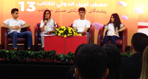 "Rose, 15, who bought Is Biology Woman's Destiny? at booth, speaks at book fair panel on ""Humanity and Its Link to Peace."" ""Religions separate us,"" she said. ""We should unite as one. ... How many more wars must we suffer from?"""