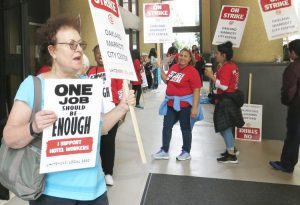 Carole Lesnick, left, who ran as Socialist Workers Party candidate for U.S. House from Oakland, joins striking Marriott hotel workers on picket line there. SWP calls for need to build unions.