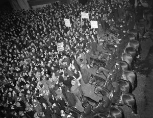 A meeting by fascist German American Bund at Madison Square Garden on Feb. 20, 1939, was met by a demonstration of 50,000, above, initiated by the Socialist Workers Party and backed by unions and others. There is no similar rise in fascist gangs and anti-Semitism today. Combating Jew-hatred is a life or death question for the working class and labor movement.