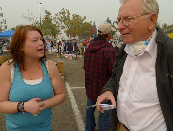Socialist Workers Party member Jeff Powers talks with fire survivor Denise Chester Nov. 15 at Chico Walmart parking lot camp.