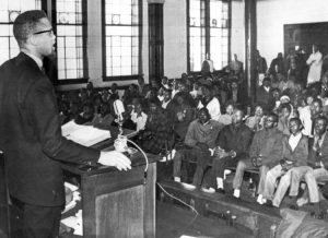 Malcolm X speaks to young people in Selma, Alabama, Feb. 4, 1965, during civil rights battles there. Listen to what everybody else says, but come to a decision for yourself, Malcolm advised.