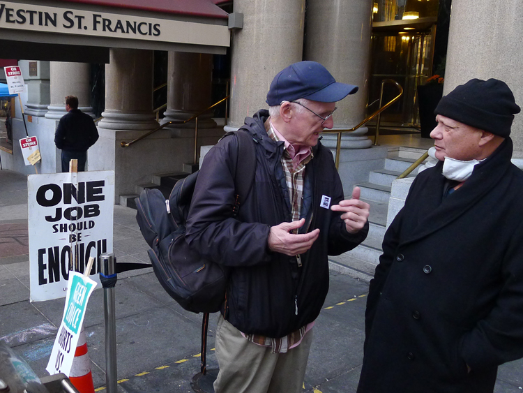 "Socialist Workers Party member Joel Britton, left, speaks with Marriott hotel striker and UNITE HERE member Carlos Zevallos at Westin St. Francis hotel in San Francisco Nov. 18. Zevallos got a Militant subscription. ""Without the union,"" he said, ""I might be one of the homeless."""