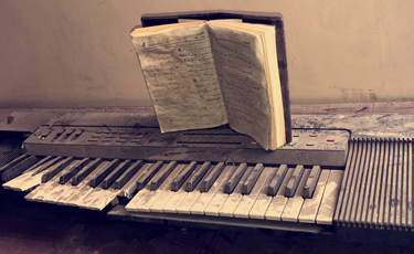 Students at University of Mosul art department keep broken keyboard as reminder of reactionary Islamic State rule in city.