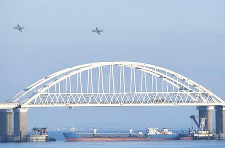 Russian fighter jets fly over Kerch bridge with Russian tanker blocking access to Sea of Azov during assault on, seizure of three Ukrainian naval boats and their 24 crew members Nov. 25.