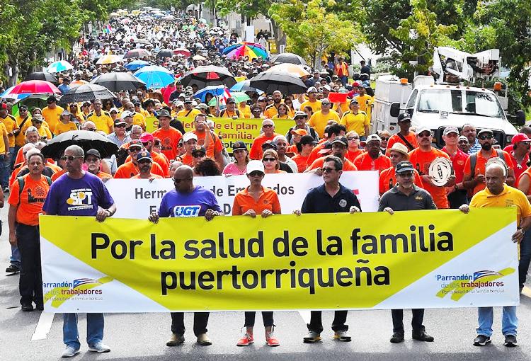 Puerto Rico unions protest gov't health care cuts