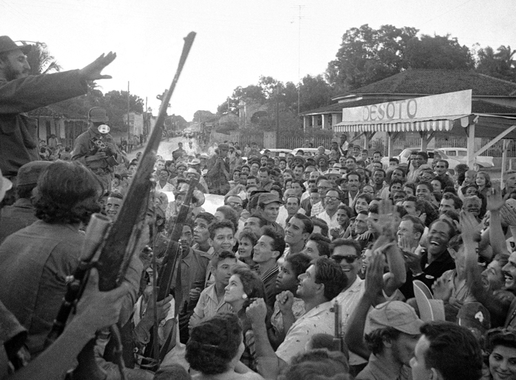 "People in Colón, Cuba, greet Fidel Castro, above left, Jan. 7, 1959, as ""Liberty Caravan"" went to Havana. Castro led Rebel Army, Cuban workers and farmers to victory, then led millions to carry out, defend socialist revolution."