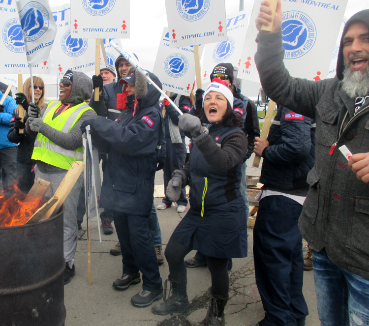 Members of Canadian Union of Postal Workers picket St. Laurent sorting plant near Montreal Oct. 30. The workers conducted rotating strikes for six weeks demanding increased hiring, end to forced overtime. Workers rallied Dec. 1 against government order to go back to work.